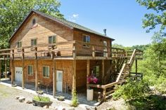 2 story art studio/workshop/garage with a log home on 10.5 acres with panoramic vistas, 1 acre pond for sale in West Virginia mountains. Vacation/second home.  RealPlanz.com