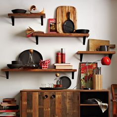 Instead of bookshelves, perhaps some open bookshelves in the living room to take up some wall space?