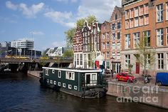 City of Amsterdam cityscape, Korte Prinsengracht canal, barge houseboat and historic houses, Holland, Netherlands.