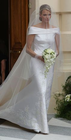 Princess Charlene of Monaco wore Armani on her wedding day. Her gown was created from white silk duchess, silk organza, 40,000 Swarovski crystals, 20,000 mother of pearl teardrops and 30,000 gold stones in a blooming floral pattern. Fit for a princess!