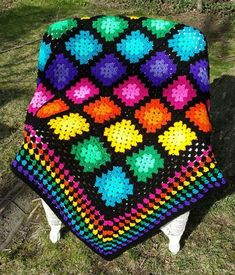 Crochet Squares Design Multicolor Granny Square Throw - Brighten up any space with this rainbow of colors! Perfect for a child's room, a porch in Summer, or that back yard hammock. Made with acrylic yarn. Machine washable and dryable. Crochet Afghans, Crochet Motifs, Afghan Crochet Patterns, Baby Blanket Crochet, Crochet Cushions, Crochet Pillow, Crochet Poncho, Crochet Stitches, Crochet Baby