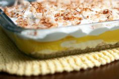 This recipe for lemon dessert lasagna is a refreshing summertime dessert that will give you your sugar fix, and you won't even have to spend much time with your oven. Serve this Lemon Lasagna Recipe for dessert on a hot day! Lemon Lush Dessert, Lemon Dessert Recipes, Coconut Recipes, Lemon Recipes, Just Desserts, Delicious Desserts, Yummy Food, Fun Food, Lemon Lasagna