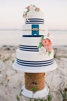 Nautical Wedding cake! I love this idea with the knot in gold and more coral in the flowers!