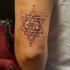 Geometric triangle tattoo