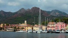 the small marina of Porto Azzurro, Elba Island, Tuscan Archipelago, Italy. - Stock Footage