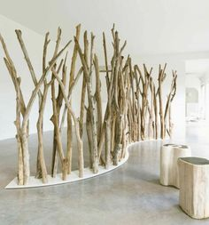 The Natural Form Of Wooden Logs Acts As An Excellent Room Divider For  Exhibition Places.