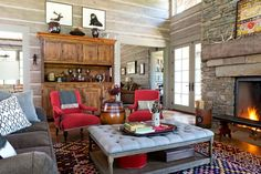 """""""Cabin"""" doesn't have to be synonymous with """"masculine."""" The home-owner brought in soft touches such as the plush coffee table from Wisteria."""