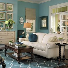 I'm liking the blue and white...paint the built ins, couch cover the couch...