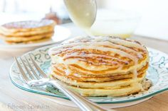 Fluffy pancakes with a cinnamon roll filling swirl, then topped with a cream cheese frosting. Perfect recipe for an indulgent weekend brunch or breakfast!