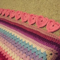 Ravelry:Free Line of Hearts Crochet Edging pattern by Jay Greengrass. Free pattern found here:  http://www.rainbowknits.co.uk/wp-content/uploads/2013/02/donation-Line-of-Hearts-Crochet-Edging.pdf