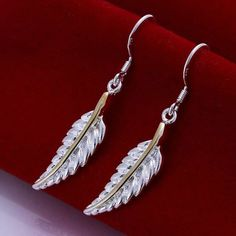 Sterling Silver funky feathered earrings $15 www.facebook.com/shivegatreasure