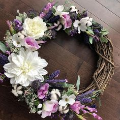 Farmhouse Decor is one of my favorites feels in a home! It is warm and cozy and adds a touch of nature. This beautiful partially filled grapevine design has additions of lavender and cotton along with spring blooms that are sure to brighten up your home whether it be over a mantle, on a