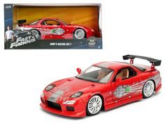 "Dom's Mazda RX-7 Red ""Fast and Furious"" Movie 1/24 Diecast Model Car by Jada - Brand new 1:24 scale diecast model car of Dom's Mazda RX-7 Red ""Fast and Furious"" Movie die cast car model by Jada. Rubber tires. Brand new box. Detailed interior, exterior. Has opening hood, doors and trunk. Made of diecast with some plastic parts. Dimensions approximately L-8, W-3.75, H-3.25 inches. Please note that manufacturer may change packing box at any time. Product will stay exactly the same.-Weight: 2…"