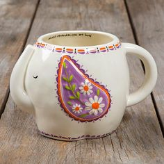 Elephant Folk Art Mug This folk art mug will have anyone smiling every time they drink from it! With a sweet elephant design, they'll be reminded that 'Always remember you are loved' each time they pi