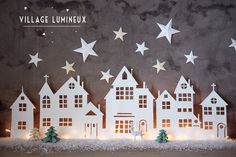 Free pdf download and tutorial for making lit paper Christmas town scene