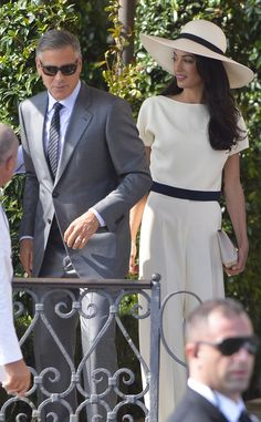 Power Couple from Amal Alamuddin's Street Style This crisp cream outfit perfectly coordinates with George's debonair style.