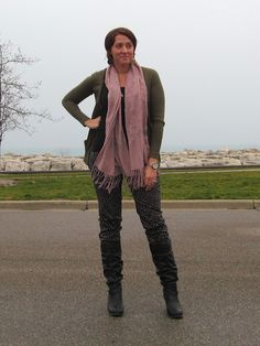 polka dot pants, pink scarf, army green jacket, black boots. Fall outfit of the day.