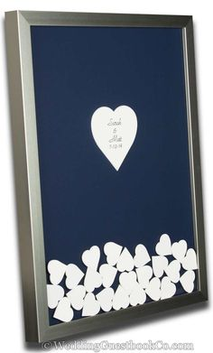 What a beautiful wedding guestbook idea that is personalized. Pick your frame style, frame color, background color, center colors and shape, drop in colors and shapes. By WeddingGuestbookCo.com unique wedding guest books #wedding #weddingideas