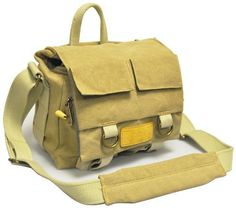 Opteka Excursion Series C500 Weatherproof Canvas Shoulder Bag for Photo and Video Cameras by Opteka. $49.95. The Opteka C500 Khaki canvas bag with leather trim is designed to carry a rangefinder or a small digital SLR camera with an attached short lens, 1 additional lens, flash and accessories. The bag is constructed from dual laminate weatherproof canvas with a high-density, fully removable closed-cell dura-foam interior with two dividers. It has a quick-fold t...
