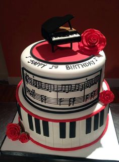 A cake for the music lover! The handmade edible piano topper was a blast to make!
