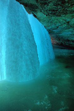 """Behind the frozen falls"" Minnehaha Falls in Minnehaha Park, Minneapolis, MN (overlooking the Mississippi River); photographer Douglas Feltman underexposed the 3 shots it took to create this image to bring out the color in the blue ice..... I have to go here"