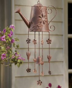 Watering Can Wind Chime. Cute. If the sounds of a wind chime didn't freak me out...