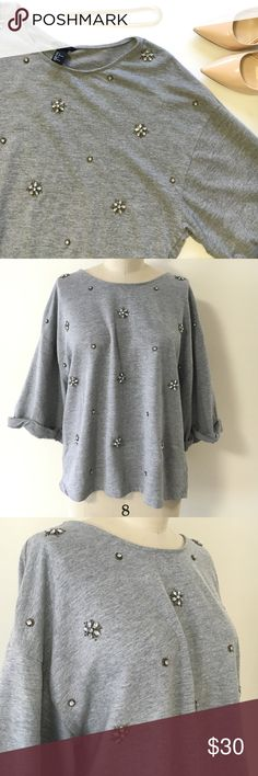 H&M jeweled top sz L Super cute jeweled top. No missing stones. Stoned have gold in them. Happy buying!!! H&M Tops Tees - Short Sleeve