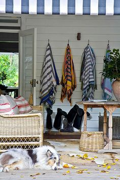Good idea for hanging beach towels on the screen porch at the lake. Put hooks on the other side of the porch for towels Les Hamptons, Relax, Lake Cottage, Home And Deco, Beach Cottages, Coastal Living, Decoration, Outdoor Living, Outdoor Spaces