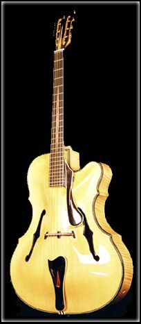 The magnificent Boaz Clarita Negra jazz guitar - the entire guitar, not just the top, is hand carved! http://www.claritanegra.com/guitars-jazznegra.htm