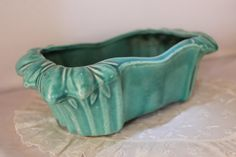 This Turquoise planting Dish was made by the McCoy Pottery Co. A small nick and some age crazing which is very common with this type of pottery.