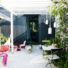 """A stenciled deck turns the backyard into a """"room"""""""
