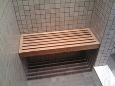 Built-in shower bench makes it possible to shave legs in a small space