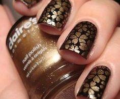 gold and black sakura nails