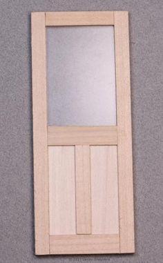 Simple dolls house door with window and panel trim. - Photo © 2011 Lesley Shepherd