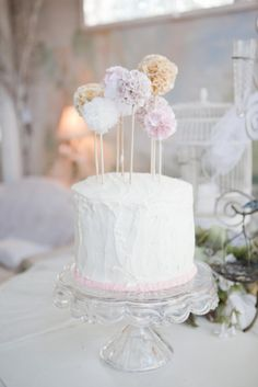 pom poms on sticks as cake topper