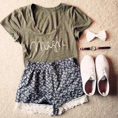 Gorgeous modern shorts with top hunter green magic tee and white soft shoes and watch and white bow the best summer outfits