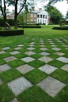 Make the best of both worlds using green grass paired with square pavers
