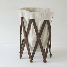 V would use it for laundry; I'd try to put a leafy plant in it. Either way, the design works!