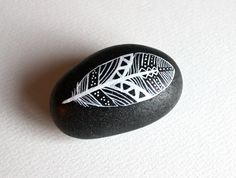 Painted Feather Stone - Patterned Feather Original Hand-Painted Large Stone. $25.00, via Etsy.