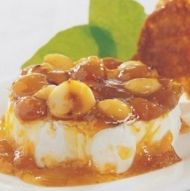 Indulge with this decadent recipe for Camembert with Macadamia and Gooseberry Glaze