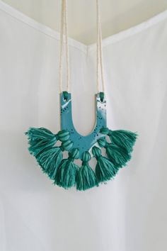 Polymer clay tassel necklace in teal blue by Kelaoke on Etsy