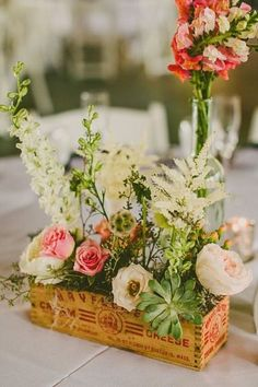 Love this centerpiece! | Asheville Mountain Wedding | Photography by Carolyn Scott See more: : http://mountainsidebride.com/2014/02/asheville-mountain-wedding-with-vintage-details
