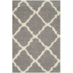 Anchor your dining set or living room seating group in chic style with this loomed shag rug, showcasing a classic trellis motif for eye-catching appeal.