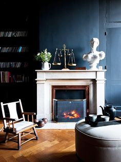LOVE this black wall accentuated by the white mantle.