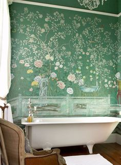 Beautiful bathroom. Love the green/floral walls.
