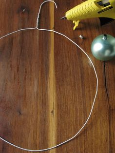http://www.eddieross.com    make a wreath from a wire hanger and cheap round christmas ornaments
