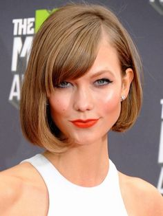 ModelKarlie Klosskeeps it classic with her timelessly chic blunt bob. She modernizes the look by giving her bangs a soft sweep and creating a deep side part. For the same bounce and body, apply some light volumizing serum on roots before drying with a round brush, curling under at the ends.                                     via @AOL_Lifestyle Read more: http://www.aol.com/article/2015/09/28/35-bobs-haircuts-that-look-amazing-on-everyone/20630851/?a_dgi=aolshare_pinter...
