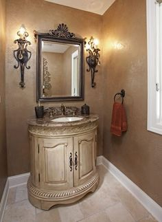 Specialty painted texture on walls; Olympia brushed and chiseled travertine flooring and Savoy House sconces