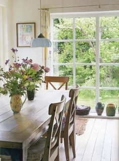 farm house table dining-room - love the floor to celling window as well