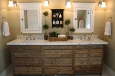 Master Bathroom Idea. The white counter top is a great accent to the rustic wood.